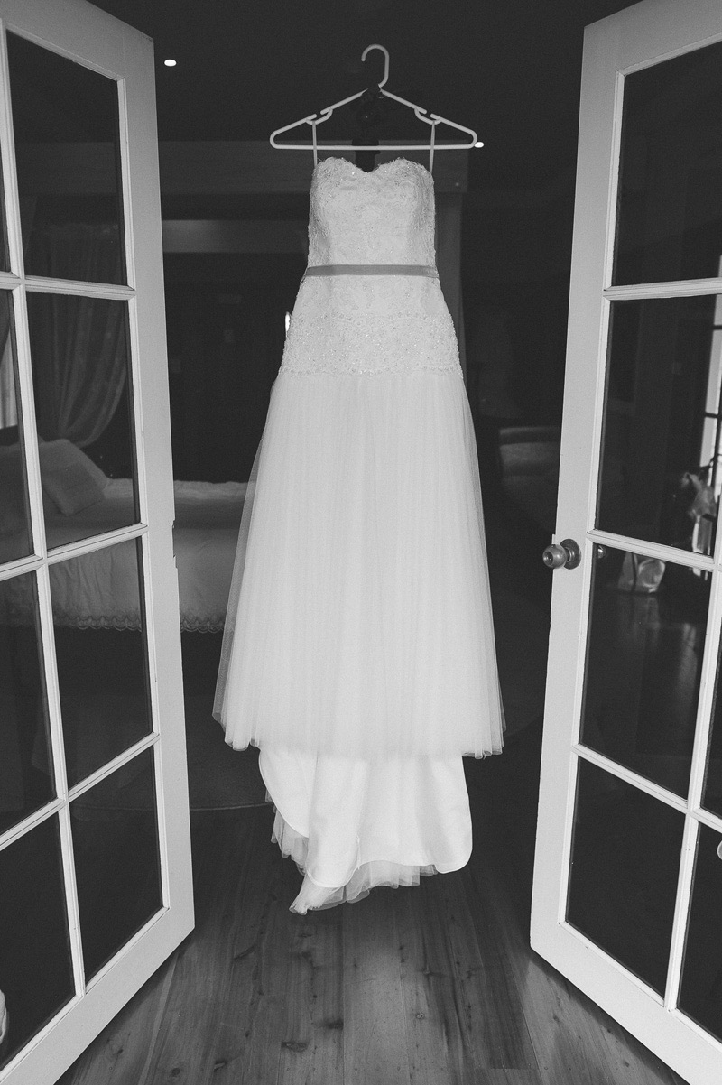 sweetheart wedding dress hanging in the doorway loxley on bellbird hill blue mountains photography