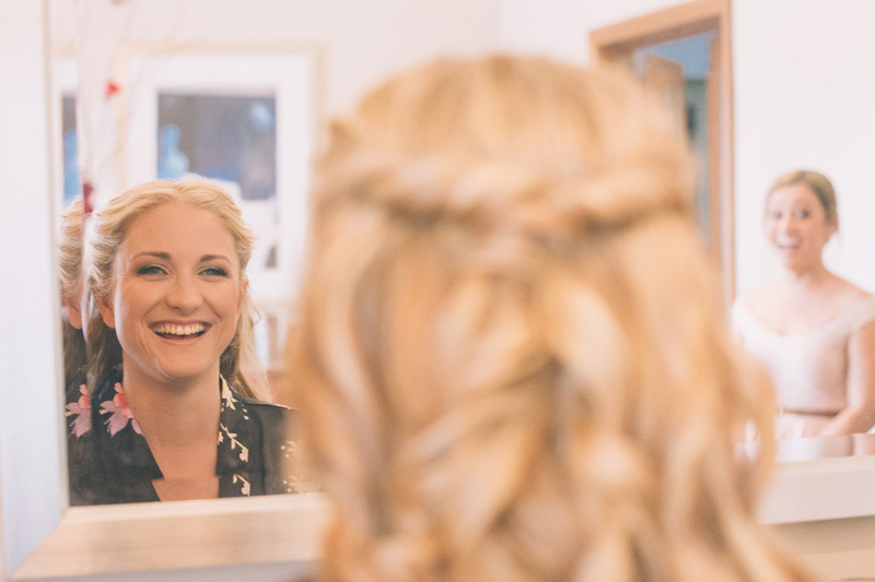 happy bride with her awesome hairstyle getting ready for the ceremony at loxley on bellbird hill blue mountains