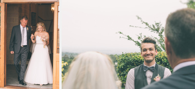 bride walks down the aisle with her father over looking the blue mountains