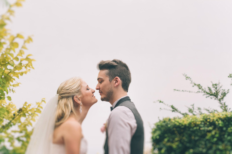 bride and groom about to kiss at their rustic diy wedding in the blue mountains