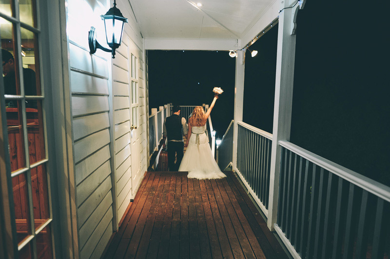 Bride and groom say goodnight to guests at their rustic DIY Wedding